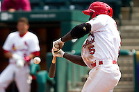 Jermaine Curtis (5) of the Springfield Cardinals makes solid contact during a game against the Midland RockHounds on April 19, 2011 at Hammons Field in Springfield, Missouri.  Photo By David Welker/Four Seam Images