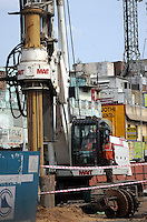 Worder with heavy machines at construction site in Madras, India