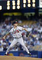 Greg Maddux of the Atlanta Braves pitches during a 2002 MLB season game against the Los Angeles Dodgers at Dodger Stadium, in Los Angeles, California. (Larry Goren/Four Seam Images)