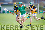 Ballyduffs Dylan Moriarty been tracked by Jedd and Oisin Maunsell of Abbeydorney in the Minor Hurling Championship semi final.