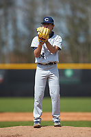 Catawba Indians relief pitcher Connor Garcia (24) looks to his catcher for the sign against the Queens Royals during game one of a double-header at Tuckaseegee Dream Fields on March 26, 2021 in Kannapolis, North Carolina. (Brian Westerholt/Four Seam Images)