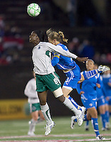 St Louis Athletica defender Tina Ellertson (8) and Boston Breakers midfielder-forward Kristine Lilly (13) battle for head ball. The Boston Breakers defeated Saint Louis Athletica, 2-0, at Harvard Stadium on April 11, 2009.