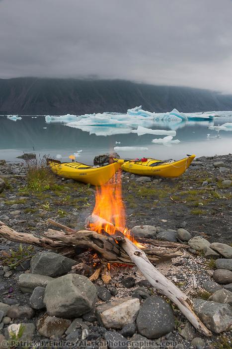 Campfire on a beach in Bear Glacier Lagoon, Kenai Fjords National Park, southcentral, Alaska.