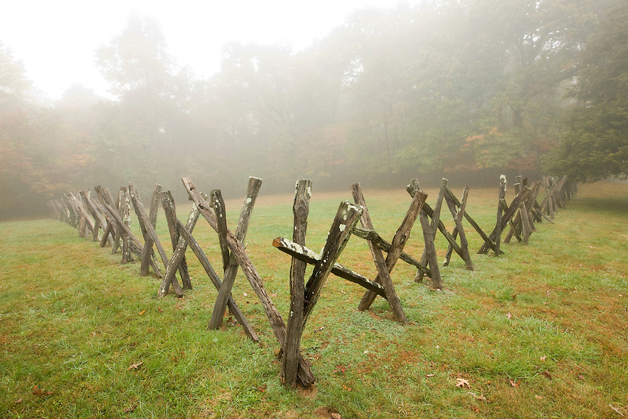 Fog fill pasture near old historical wooden fence on the Blue Ridge Parkway.