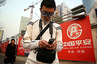 CHINA. Shanghai. A man using his cellphone in the modern Pudong area. Shanghai is a sprawling metropolis or 15 million people situated in south-east China. It is regarded as the country's showcase in development and modernity in modern China. This rapid development and modernization, never seen before on such a scale has however spawned countless environmental and social problems. 2008