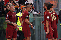 Calcio, Serie A: Lazio vs Roma. Roma, stadio Olimpico, <br /> Roma's Radja Nainggolan celebrates with teammates after scoring during the Italian Serie A football match between Lazio and Rome at Rome's Olympic stadium, 4 December 2016. Roma won 2-0.<br /> UPDATE IMAGES PRESS/Riccardo De Luca