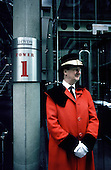 Doorman outside the Lloyds Building in the City of London