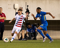 PHILADELPHIA, PA - JUNE 30: Tyler Boyd #21 attempts to evade Kenji Gorre #14 during a game between Curaçao and USMNT at Lincoln Financial Field on June 30, 2019 in Philadelphia, Pennsylvania.