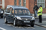 © Joel Goodman - 07973 332324 . 16/01/2014 . Salford , UK . Police bow their heads as the cortege arrives . The funeral of Labour MP Paul Goggins at Salford Cathedral today (Thursday 16th January 2014) . The MP for Wythenshawe and Sale East died aged 60 on 7th January 2014 after collapsing whilst out running on 30th December 2013 . Photo credit : Joel Goodman