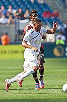 Olimpia midfielder Carlos Will Mejia (7)  receives a pass with AC Milan midfielder Kevin Constant (21) in pursuit.  AC Milan defeated Olimpia 3-1 at Gillette Stadium on August 4, 2012