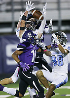 Fayetteville and Southside players reach for a long pass, Friday, October 9, 2020 during a football game at Fayetteville High School in Fayetteville. Check out nwaonline.com/2010010Daily/ for today's photo gallery. <br /> (NWA Democrat-Gazette/Charlie Kaijo)