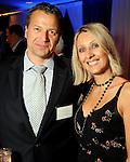 Tor Gauem and Marina Miklaszewick at the Technip reception at the Hotel Derek Tuesday May 1,2012. (Dave Rossman Photo)