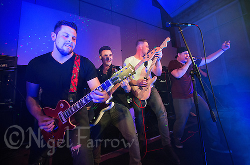 10 Jan 2015 - STOWMARKET, GBR - Renegade Twelve perform at the John Peel Centre for Creative Arts in Stowmarket, Suffolk, Great Britain. From the left Dan Potter(lead guitar), Josh Barnard (bass guitar), Jake Mayes, (lead guitar) and Sam Robson (vocals) (PHOTO COPYRIGHT © 2015 NIGEL FARROW, ALL RIGHTS RESERVED)