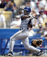 Jeffery Hammonds of the Milwaukee Brewers bats during a 2002 MLB season game against the Los Angeles Dodgers at Dodger Stadium, in Los Angeles, California. (Larry Goren/Four Seam Images)