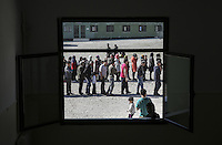 Pictured: Queues of refugees waiting for food Friday 26 February 2016<br /> Re: Hundreds of refugees have been given temporary shelter at the Stefanakis Army Camp in the Schisto area of Athens, Greece.