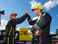Sep 3, 2018; Clermont, IN, USA; NHRA pro stock driver Tanner Gray (right) is congratulated by Jeg Coughlin Jr as he celebrates after winning the US Nationals at Lucas Oil Raceway. Mandatory Credit: Mark J. Rebilas-USA TODAY Sports