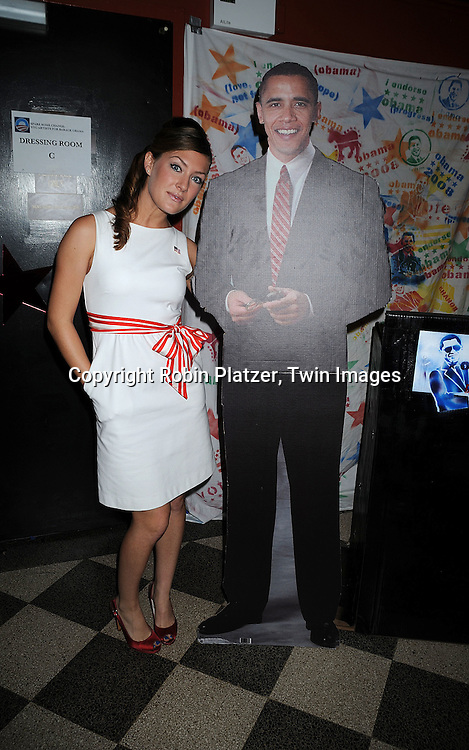 """BethAnn Bonner and cutout of Barack Obama..at The """"Spare Some Change:NYC Artists for Barack Obama""""  fundraiser on August 11, 2008 at The Fifth Floor Theatre at New York University. ....Robin Platzer, Twin Images"""