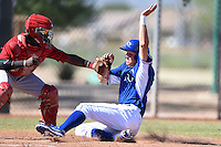 Kansas City Royals outfielder Brandon Downes (45) slides into home as Shedric Long (30) applies the tag during an Instructional League game against the Cincinnati Reds on October 14, 2014 at Goodyear Training Facility in Goodyear, Arizona.  (Mike Janes/Four Seam Images)