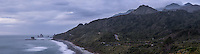 Moody weather after sunset on wild coastline near Rapahoe near Greymouth with coastal road on right, West Coast, Buller Region, South Island, New Zealand, NZ