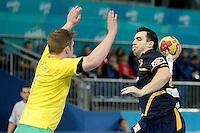 Spain's Carlos Ruesga Pasarin (r) and Australia's Tommy Fletcher during 23rd Men's Handball World Championship preliminary round match.January 15,2013. (ALTERPHOTOS/Acero) /NortePhoto