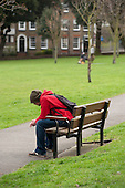 Young man on a park bench, Margate.