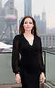 (News-Item): Actress Angelina Jolie posed for these pictures in the city of Shanghai, China, where she arrived to promote her latest movie ' Maleficent'. Shanghai, China, June 4th, 2014