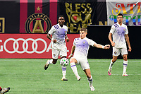 ATLANTA, GA - AUGUST 29: Chris Mueller #9 of Orlando City clears the ball during a game between Orlando City SC and Atlanta United FC at Marecedes-Benz Stadium on August 29, 2020 in Atlanta, Georgia.