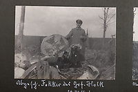 BNPS.co.uk (01202 558833)<br /> Pic: C&TAuctions/BNPS<br /> <br /> Pictured: A German officer poses for a photograph with a crashed Fokker aircraft. <br /> <br /> Fascinating previously unseen World War One photos showing the conflict from the German perspective have come to light 103 years on.<br /> <br /> Major Hans Rudloff, a distinguished artillery officer, took hundreds of images of some of the major Western Front battles.<br /> <br /> There are scenes of destruction on the Verdun and at Cambrai, as well as snapshots of captured British soldiers on the Somme in the early days of the German Spring Offensive in March 1918.