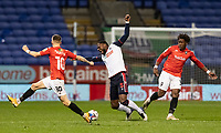 Bolton Wanderers' Ricardo Santos (centre) is fouled by Salford City's Brandon Thomas-Asante (right) <br /> <br /> Photographer Andrew Kearns/CameraSport<br /> <br /> The EFL Sky Bet League Two - Bolton Wanderers v Salford City - Friday 13th November 2020 - University of Bolton Stadium - Bolton<br /> <br /> World Copyright © 2020 CameraSport. All rights reserved. 43 Linden Ave. Countesthorpe. Leicester. England. LE8 5PG - Tel: +44 (0) 116 277 4147 - admin@camerasport.com - www.camerasport.com