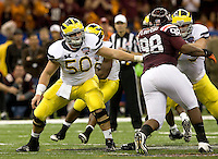 Michigan offensive linemen Michael Schofield and David Molk are in action during Sugar Bowl game against Virginia Tech at Mercedes-Benz SuperDome in New Orleans, Louisiana on January 3rd, 2012.  Michigan defeated Virginia Tech, 23-20 in first overtime.