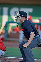 Umpire Bobby Tassone handles the calls behind the plate during the game between the Ogden Raptors and the Orem Owlz at Lindquist Field on June 26, 2018 in Ogden, Utah. The Raptors defeated the Owlz 6-5. (Stephen Smith/Four Seam Images)