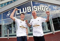 Saturday, 06 June 2015<br /> Pictured L-R: Two of the shoppers that entered the shop first, Daniel Lewis 15 with his uncle Pat Jones. <br /> Re: Swansea City FC new home kit launch at the club shop of the Liberty Stadium, south Wales, UK.