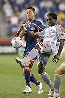 Chris Gbandi (Dallas, gray) bests Clint Dempsey (Revolution, blue). The New England Revolution defeat FC Dallas, 1-0, on June 28 at Gillette Stadium.