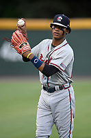 Outfielder Cristian Pache (25) of the Rome Braves warms up before a game against the Greenville Drive on Saturday, August 12, 2017, at Fluor Field at the West End in Greenville, South Carolina. Rome won, 4-0. (Tom Priddy/Four Seam Images)