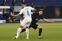 Zweikampf Victor Palsson (Island Iceland) gegen Leon Goretzka (Deutschland Germany) - 25.03.2021: WM-Qualifikationsspiel Deutschland gegen Island, Schauinsland Arena Duisburg