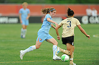 Heather O'Reilly (9) of Sky Blue FC is marked by Ali Riley (3) of FC Gold Pride. FC Gold Pride defeated Sky Blue FC 1-0 during a Women's Professional Soccer (WPS) match at Yurcak Field in Piscataway, NJ, on May 1, 2010.