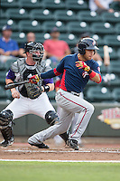 Bryan Mejia (2) of the Potomac Nationals follows through on his swing against the Winston-Salem Dash at BB&T Ballpark on July 15, 2016 in Winston-Salem, North Carolina.  The Dash defeated the Nationals 10-4.  (Brian Westerholt/Four Seam Images)