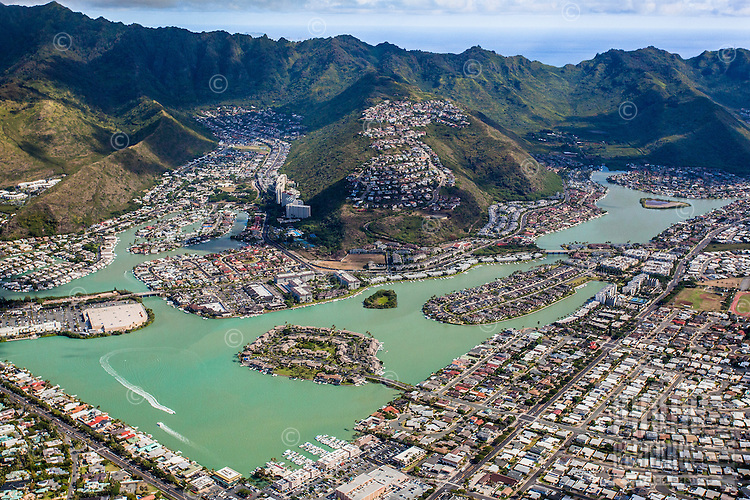 An aerial view of Hawai'i Kai that includes Haha'ione Valley, Koko Marina and Kuapa Pond, Honolulu, O'ahu.