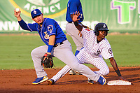 Biloxi Shuckers second baseman Keston Hiura (18) and Jackson Generals shortstop Jose Vinicio (20) look to the ump to make a call during a Southern League game on July 26, 2018 at The Ballpark at Jackson in Jackson, Tennessee. Jackson defeated Biloxi 9-5. (Brad Krause/Four Seam Images)