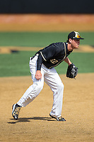 Wake Forest Demon Deacons third baseman Joe Napolitano (12) on defense against the Miami Hurricanes at Wake Forest Baseball Park on March 22, 2015 in Winston-Salem, North Carolina.  The Demon Deacons defeated the Hurricanes 10-4.  (Brian Westerholt/Four Seam Images)