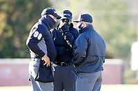 Umpires Patrick Graham (home plate), Zach Neff (third) and Rusty Griffin (first) discuss a play in a game between the University of South Carolina Upstate Spartans and the University of Toledo Rockets on Saturday, February 20, 2021, at Cleveland S. Harley Park in Spartanburg, South Carolina. Upstate won, 5-1. (Tom Priddy/Four Seam Images)
