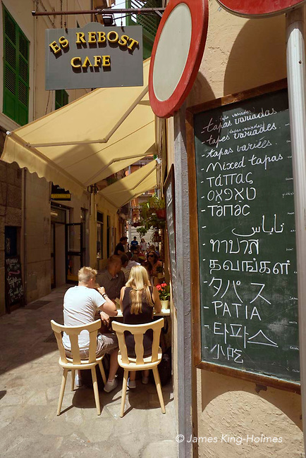 Multi-lingual menu outside a cafe in central Palma de Mallorca. The available food is listed in Catalan, Spanish, French, English, Greek, Yiddish, Russian, Arabic, Tamil, Japanese, Maltese, Korean and Chinese.