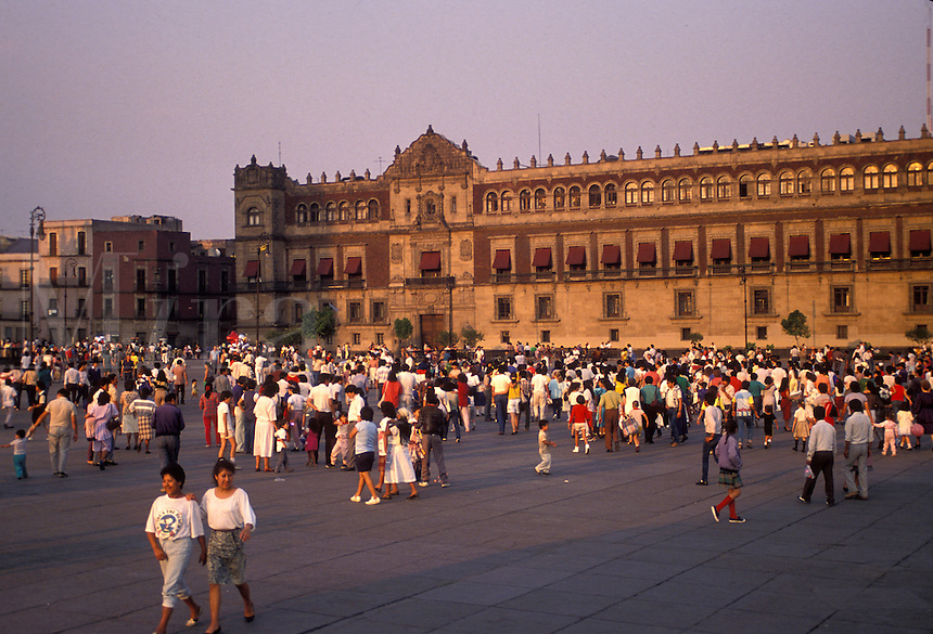 AJ1880, Mexico City, Mexico, National Palace, Plaza Zocalo, People walking in the Plaza Zocalo in front of the National Palace (Palacio Nacional) in Mexico City in the state of Distrito Federal.