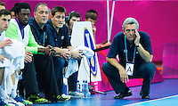 08 AUG 2012 - LONDON, GBR - Claude Onesta (FRA) (right), the head coach of France, struggles to watch his team during the men's London 2012 Olympic Games quarter final match against Spain at the Basketball Arena in the Olympic Park, in Stratford, London, Great Britain (PHOTO (C) 2012 NIGEL FARROW)