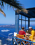 Greece; Cyclades; Santorini; Fira (Thira): Restaurant with view across the Caldera and island Nea Kameni
