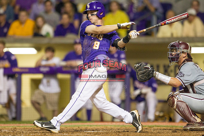 LSU Tigers shortstop Alex Bregman (8) doubles during a Southeastern Conference baseball game against the Texas A&M Aggies on April 24, 2015 at Alex Box Stadium in Baton Rouge, Louisiana. LSU defeated Texas A&M 9-6. (Andrew Woolley/Four Seam Images)