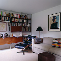 An Eames black leather reclining chair occupies a corner of the study which has a photograph of Deborah Berke above the sofa