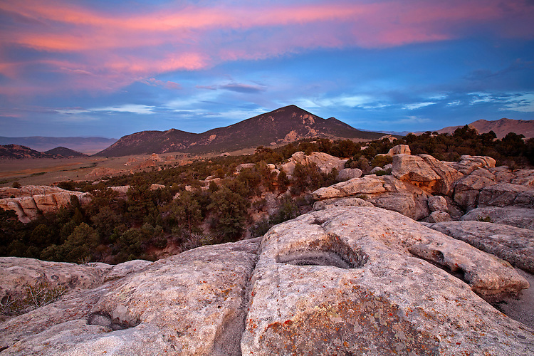 A colorful sunset appears above the granite slabs in City of Rocks National Reserve in Idaho, USA