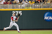 North Carolina State outfielder Brett Williams (3) makes a running catch during Game 10 of the 2013 Men's College World Series against the North Carolina Tar Heels on June 20, 2013 at TD Ameritrade Park in Omaha, Nebraska. The Tar Heels defeated the Wolfpack 7-0, eliminating North Carolina State from the tournament. (Andrew Woolley/Four Seam Images)