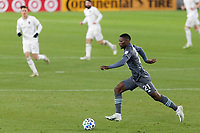 ST PAUL, MN - NOVEMBER 22: Bakaye Dibassy #21 of Minnesota United FC moves the ball during a game between Colorado Rapids and Minnesota United FC at Allianz Field on November 22, 2020 in St Paul, Minnesota.